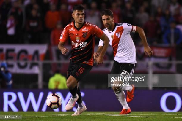 Bruno Guimaraes Rodriguez Moura of Paranaense and Leonardo Ponzio of River Plate during the second leg match of the final of the CONMEBOL Recopa...