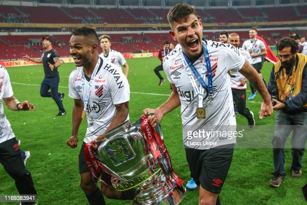 Bruno Guimarães of Athletico PR celebrates with the trophy after a match between Internacional and Athletico PR as part of Copa do Brasil Final at...