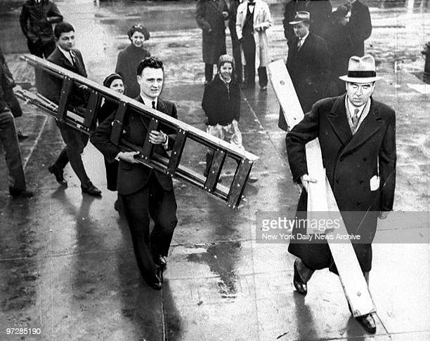 Bruno Hauptmann trial in Flemington for the kidnap and murder of Charles A Lindbergh Jr The deadly ladder and other evidence being carried into court...
