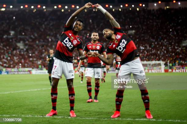 Bruno Henrique celebrates with teammate Gabriel Barbosa of Flamengo after scoring the third goal of his team during a match between Flamengo and...