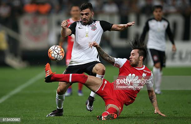 Bruno Henrique of Corinthians fights for the ball with Jonathan Gomez of Santa Fe during a match between Corinthians and Santa Fe as part of Group 8...