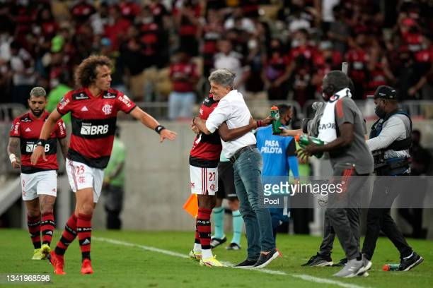 Bruno Henrique of Flamengo celebrates with Renato Gaúcho head coach of Flamengo after scoring the first goal of his team during a semi final first...
