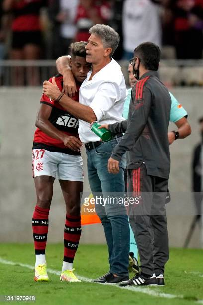 Bruno Henrique of Flamengo celebrates with Renato Gaúcho head coach of Flamengo after scoring the second goal of his team during a semi final first...