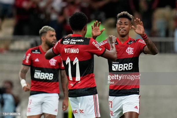 Bruno Henrique of Flamengo celebrates with teammate Vitinho after scoring the first goal of his team during a semi final first leg match between...