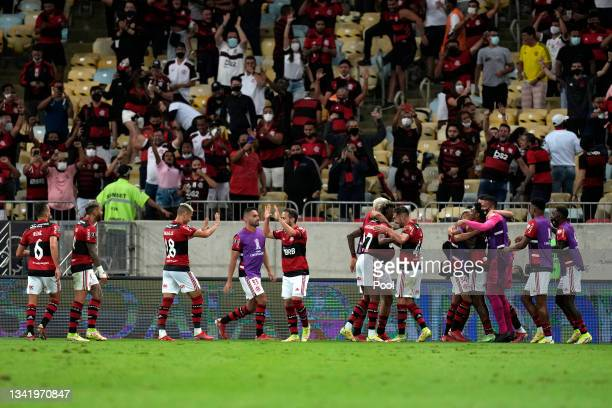Bruno Henrique of Flamengo celebrates with teammates after scoring the second goal of his team during a semi final first leg match between Flamengo...