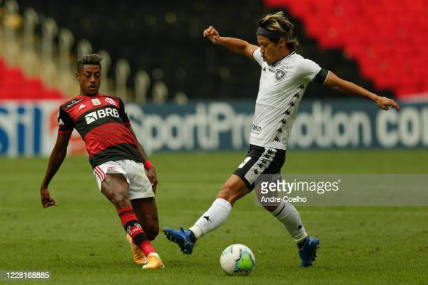 Bruno Henrique of Flamengo fights for the ball against Honda of Botafogo during the match between Flamengo and Botafogo as part of the 2020...