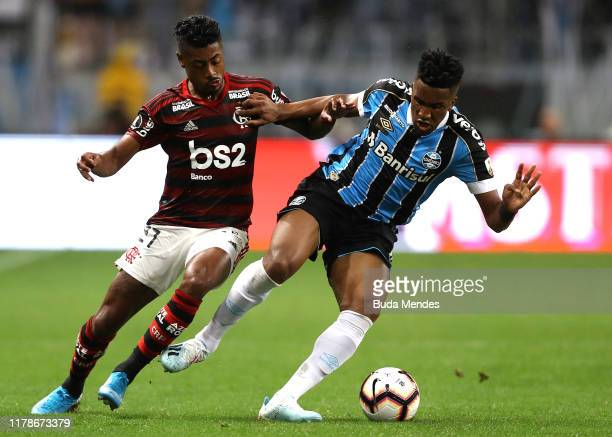 Bruno Henrique of Flamengo fights for the ball with Cortez of Gremio during a semi final first leg match between Gremio and Flamengo as part of Copa...