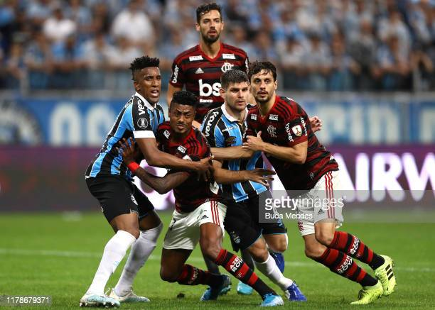 Bruno Henrique of Flamengo struggles with Cortez of Gremio struggles during a semi final first leg match between Gremio and Flamengo as part of Copa...
