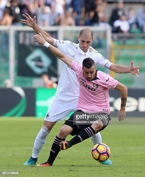 Bruno Henrique of Palermo competes for the ball with Gabriel Paletta of Milan during the Serie A match between US Citta di Palermo and AC Milan at...