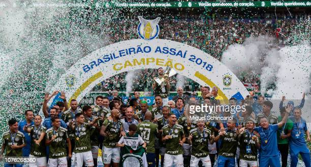 Bruno Henrique of Palmeiras holds the trophy after winning the Brasileirao 2018 after the match against Vitora at Allianz Parque on December 02 2018...