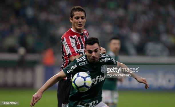 Bruno Henrique of Palmeiras vies the ball with Anderson Martins of Sao Paulo during a match between Palmeiras and Sao Paulo for the Brasileirao...