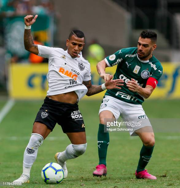 Bruno Henrique of Palmeiras vies the ball with Otero of Atletico MG during a match between Palmeiras and Atletico MG for the Brasileirao Series A...