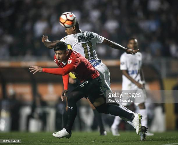 Bruno Henrique of Santos battles for the ball with Alan Franco of Independiente during the match between Santos and independiente as a part of Copa...