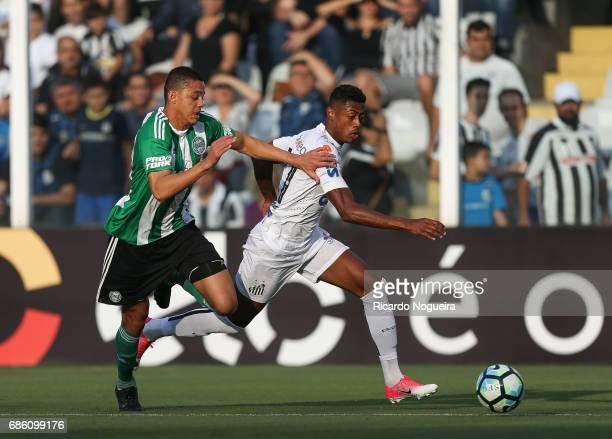 Bruno Henrique of Santos battles for the ball with Dodo of Coritiba during a match between Santos and Coritiba as a part of Campeonato Brasileiro...