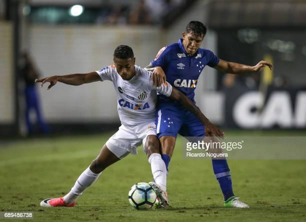 Bruno Henrique of Santos battles for the ball with Lucas Romero during the match between Santos and Cruzeiro as a part of Campeonato Brasileiro 2017...