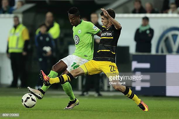 Bruno Henrique of Wolfsburg and Christian Pulisic of Dortmund compete for the ball during the Bundesliga match between VfL Wolfsburg and Borussia...