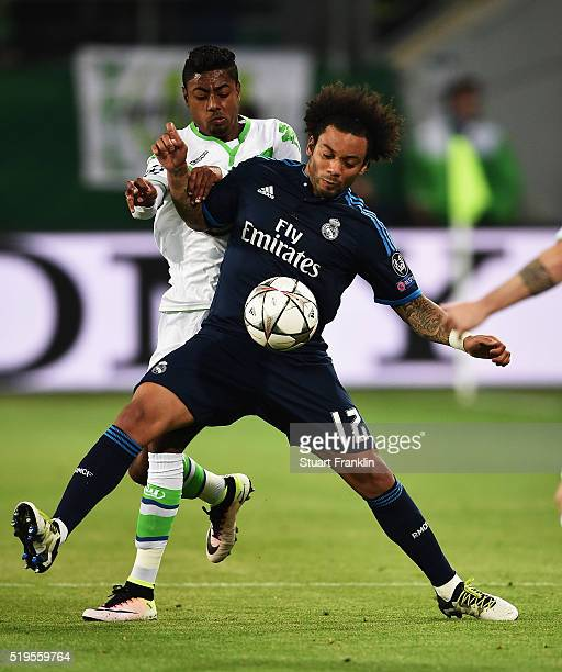 Bruno Henrique of Wolfsburg is challenegd by Marcelo of Real Madrid during the UEFA Champions League Quarter Final First Leg match between VfL...