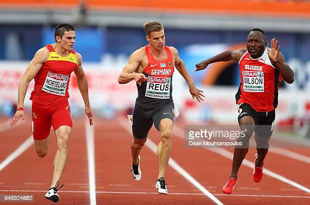 Bruno Hortelano of Spain Julian Reus of Germany and Alex Wilson of Switzerland dip for the line during their 100m semi final on day two of The 23rd...