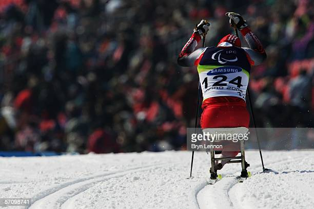 Bruno Huber of Switzerland competes in the Men's 10 KM - Sitting Cross Country during Day Five of the Turin 2006 Winter Paralympic Games on March 15,...