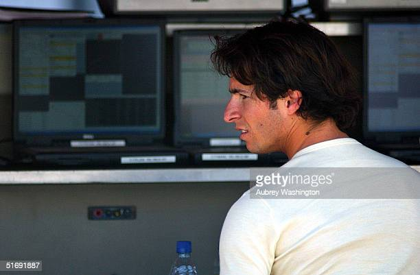 Bruno Junqueira of Brazil wait before practice and qualifying for the CART series GP at the Autodromo Hermanos Rodriguez November 6 2004 in Mexico...
