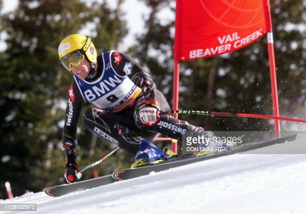 Bruno Kernen of Switzerland cuts past a gate during his run at the men's downhill combined race at the 1999 World Alpine Ski Championships 08...