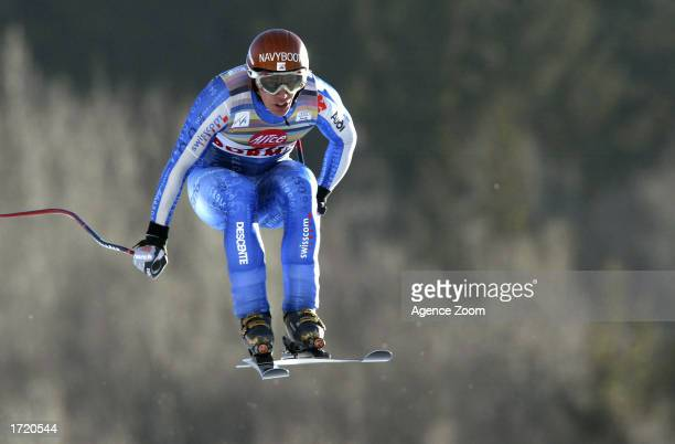 Bruno Kernen of Switzerland gets airborne en route to 7th place in the Men's Downhill event of the FIS World Cup on January 11 2003 in Bormio Italy