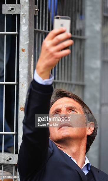 Bruno Labbadia head coach of Hamburg takes a selfie for a fan during his home debut as head coach during the Bundeslga match between Hamburger SV and...