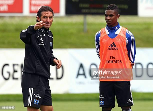 Bruno Labbadia , head coach of Hamburg talks to his player Eljero Elia during a training session at day three of the Hamburger SV training camp on...