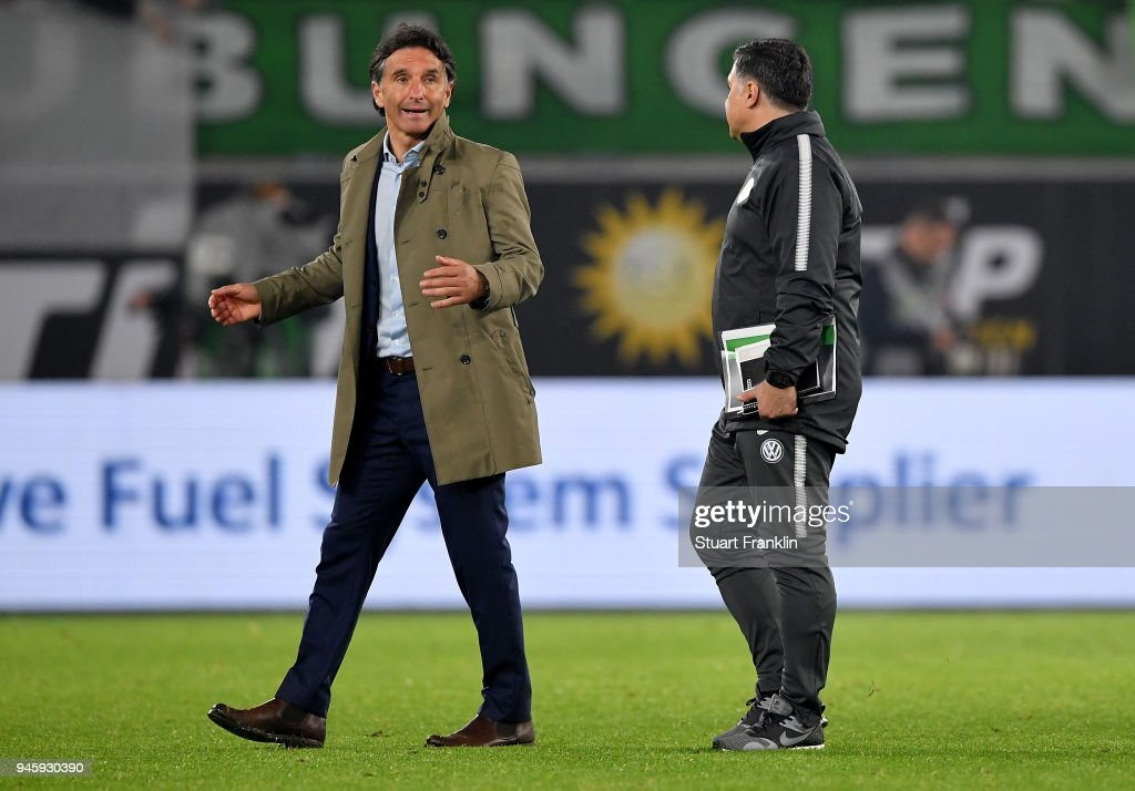 Bruno Labbadia (L), head coach of Wolfsburg and assistant coach Eddy Soezer react after the Bundesliga match between VfL Wolfsburg and FC Augsburg at Volkswagen Arena on April 13, 2018 in Wolfsburg, Germany.
