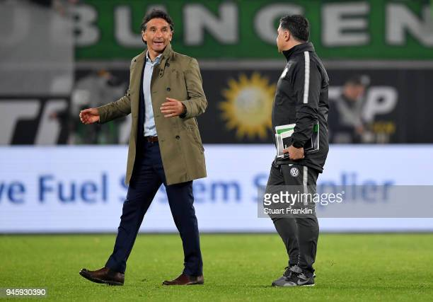 Bruno Labbadia head coach of Wolfsburg and assistant coach Eddy Soezer react after the Bundesliga match between VfL Wolfsburg and FC Augsburg at...