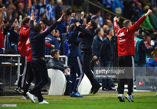 Bruno Labbadia manager of Hamburger SV celebrates with the team bench as goalkeeper Rene Adler of Hamburger SV saves a penalty during the Bundesliga...