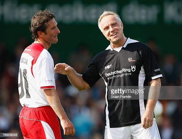 Bruno Labbadia of the Hamburg team and Michael Rummenigge of the Germany team chat during the Day Of The Legends match at the Millentor stadium on...