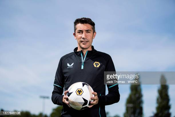 Bruno Lage poses for his first portraits as the new manager of Wolverhampton Wanderers at Sir Jack Hayward Training Ground on June 09, 2021 in...