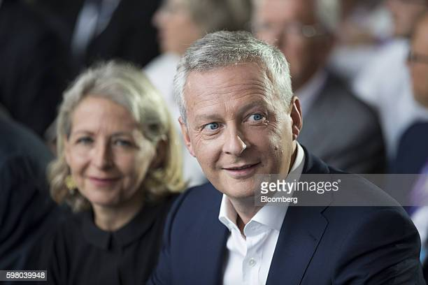 Bruno Le Maire former French agriculture minister right looks on from the audience during the MEDEF business conference in JouyenJosas France on...