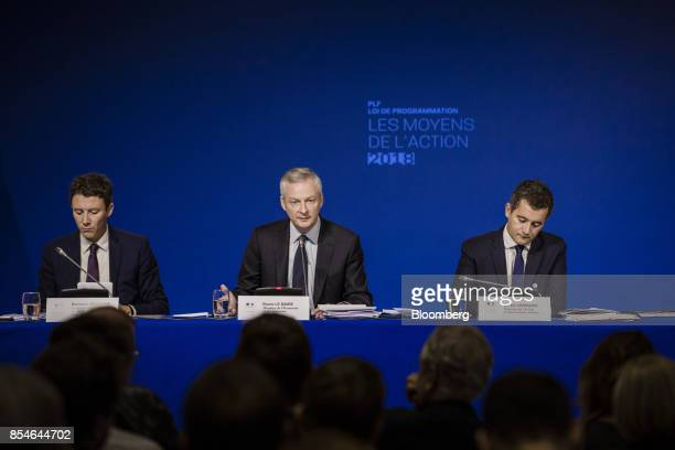 Bruno Le Maire France's finance minister center speaks as Benjamin Griveaux France's junior economy minister left and Gerald Darmanin France's...