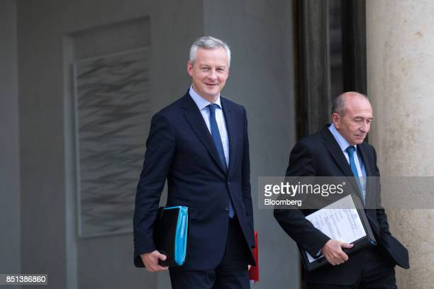 Bruno Le Maire France's finance minister left and Gerard Collomb France's interior minister depart following a cabinet meeting to approve labor law...