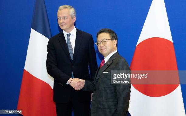 Bruno Le Maire France's finance minister left and Hiroshige Seko Japan's minister of economy trade and industry shake hands at the French Ministry of...