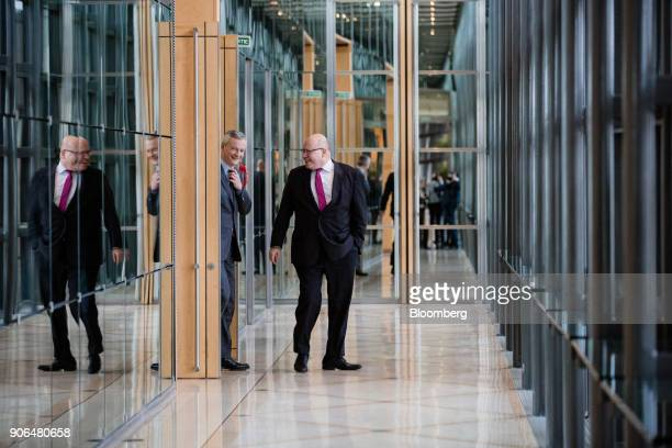 Bruno Le Maire Frances finance minister left and Peter Altmaier Germanys acting finance minister depart a news conference at the Ministry of Finance...