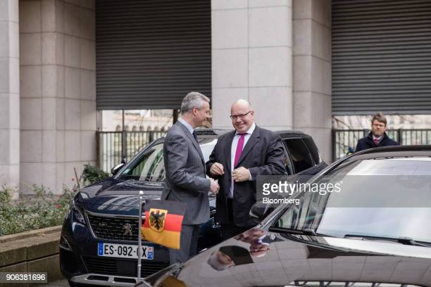 Bruno Le Maire Frances finance minister left greets Peter Altmaier Germanys acting finance minister ahead of a news conference at the Ministry of...