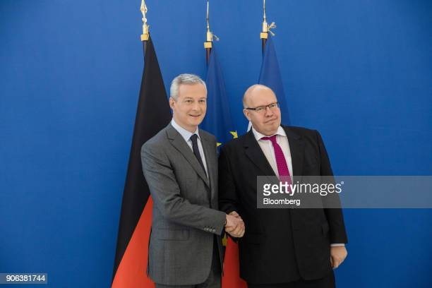 Bruno Le Maire Frances finance minister left poses for a photograph with Peter Altmaier Germanys acting finance minister ahead of a news conference...