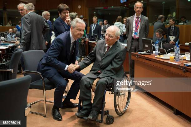 Bruno Le Maire France's finance minister left shakes hands with Wolfgang Schaeuble Germany's finance minister ahead of an Ecofin meeting of European...