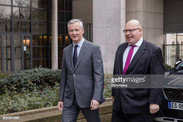 Bruno Le Maire Frances finance minister left walks alongside Peter Altmaier Germanys acting finance minister as he arrives ahead of a news conference...