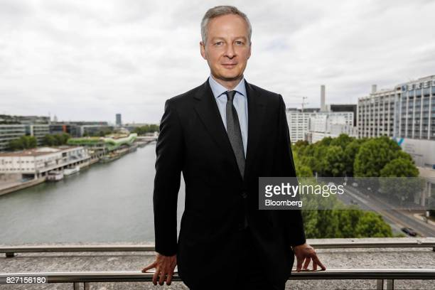 Bruno Le Maire France's finance minister poses for a photograph following an interview on a balcony overlooking the River Seine at the ministry of...