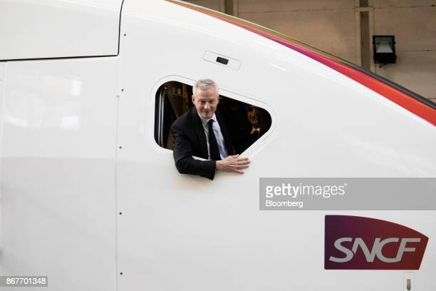 Bruno Le Maire France's finance minister poses for photographs while looking from the driver's cockpit window of a highspeed TGV train as he visits...