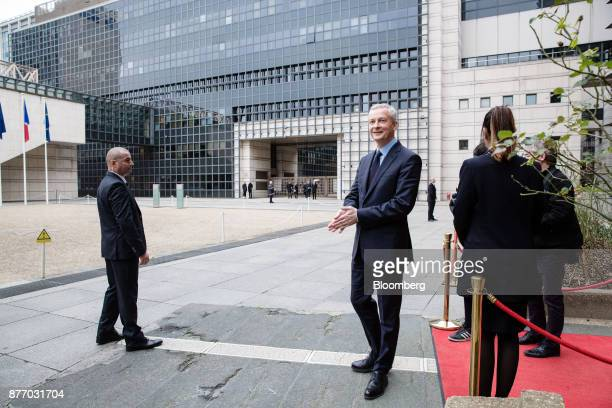 Bruno Le Maire France's finance minister right awaits the arrival of France's President Emmanuel Macron outside the French Ministry of Economy during...