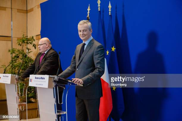 Bruno Le Maire Frances finance minister right looks on as Peter Altmaier Germanys acting finance minister speaks during a news conference at the...