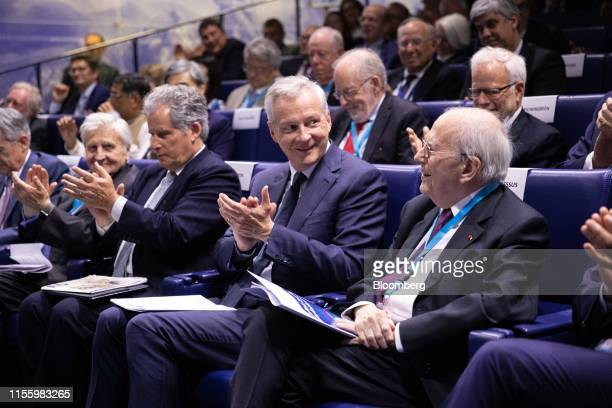 Bruno Le Maire France's finance minister second right and Michel Camdessus former managing director of the International Monetary Fund right sit...
