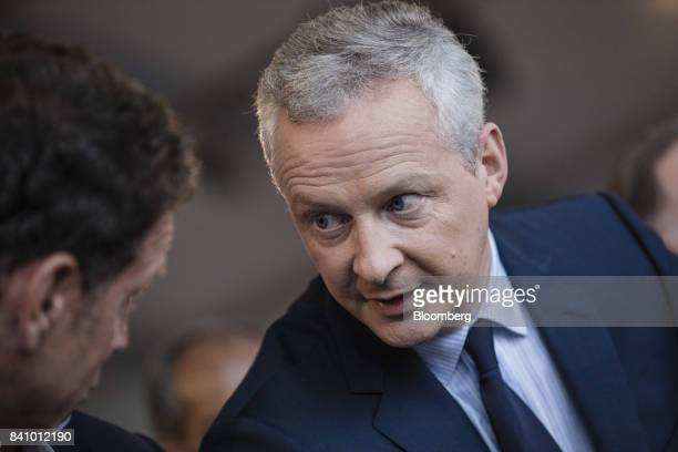 Bruno Le Maire France's finance minister speaks with an attendee at the Medef business conference in JouyenJosas France on Wednesday Aug 30 2017 The...