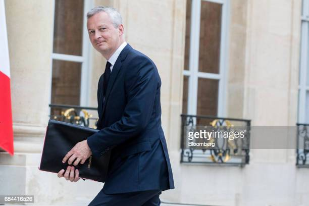 Bruno Le Maire France's minister of finance arrives for a cabinet meeting at the Elysee Palace in Paris France on Thursday May 18 2017 President...