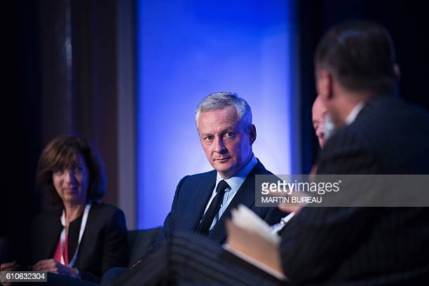 """Bruno Le Maire, French right-wing Les Republicains candidate for the LR party primaries ahead of the 2017 presidential election, attends the """"Economy..."""